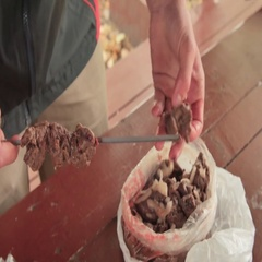 Man puts the meat on a skewer barbecue roast meat on the fire Stock Footage