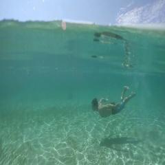 UNDERWATER: Happy young guy swimming underwater and exploring amazing ocean Stock Footage