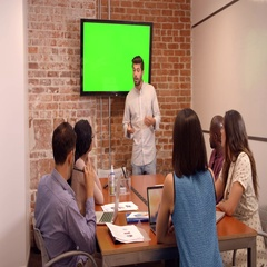 Businessman Standing By Screen To Deliver Presentation Stock Footage