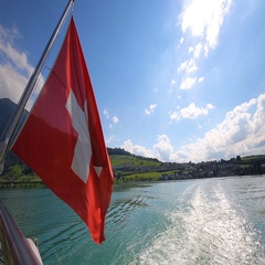 Swiss flag on the boat with Rigi mountain, Switzerland, Europe. Stock Footage