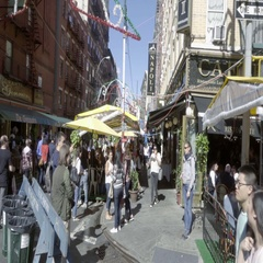 People walking crowd Feast of San Gennaro in Little Italy Manhattan NYC Stock Footage