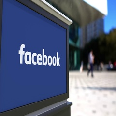 Street signage board with Facebook inscription Stock Footage
