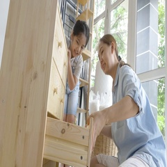 4K : Asian lovely girl helping her mother assembling new DIY furniture at home Stock Footage