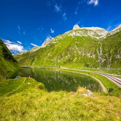 Rhaetian Railway train passing an Oberalp pass, Switzerland. Stock Footage