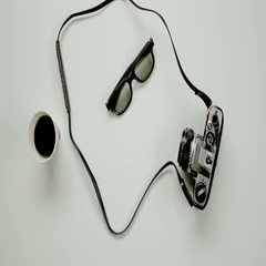 Camera, glasses, up of coffee and sticker are on white background Stock Footage