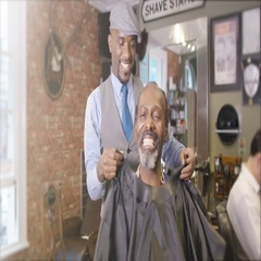 4K Friendly barber working on a customer in traditional retro barber shop Stock Footage
