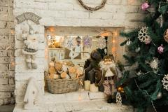Interior background with Christmas tree and fireplace. Figurine Santa with wood  Kuvituskuvat