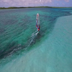 4K aerial flying past windsurfer at Lac Bay, Bonaire, Nov 2015 Stock Footage