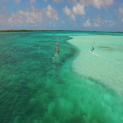4K aerial of fast windsurfers doing tricks at Lac Bay, Bonaire, Nov 2015 Stock Footage