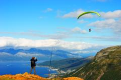 Man taking picture of Norway kite flyer background Stock Photos