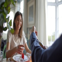 Man Opening Bottle Of Champagne At Valentines Day Meal Stock Footage