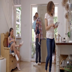 Family In Hallway Returning Home Together Stock Footage