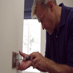 Electrician Repairing Domestic Light Switch Shot On R3D Stock Footage