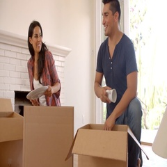 Couple Unpacking Boxes In New Home On Moving Day Stock Footage