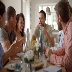 Young adult friends talking at a table over lunch, close up Stock Footage