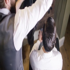 4K Male stylist preparing to cut a customer's hair in traditional retro barber s Stock Footage