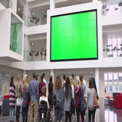 Students under big AV screen in university atrium, back view, shot on R3D Stock Footage