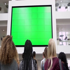 Students under big AV screen in atrium, close up back view, shot on R3D Stock Footage