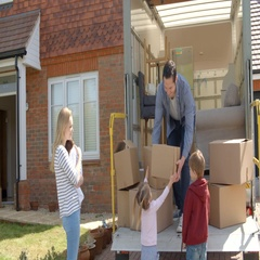 Family Unpacking Moving In Boxes From Removal Truck Stock Footage