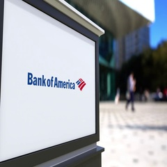 Street signage board with Bank of America logo. Blurred office center and Stock Footage