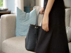 Businesswoman Relaxes On Sofa After Work Shot On R3D Stock Footage