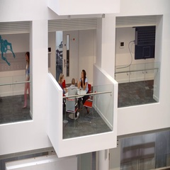 Students socialise on a mezzanine in a university building Stock Footage