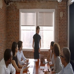Businesswoman Standing To Address Boardroom Meeting Stock Footage