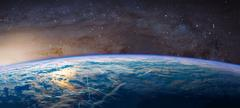 Planet Earth with appearing sunbeam light. Stock Photos