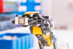 IC electronics chip in robot arm Kuvituskuvat