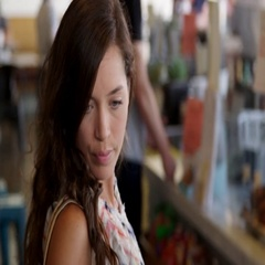 Female Customer Browsing In Delicatessen Shot On R3D Stock Footage