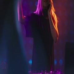 Female DJ Entertaining Crowd in Nightclub Stock Footage