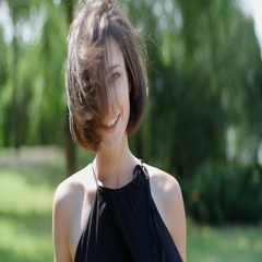 Beautiful girl with short haircut and freckles on her face smiling and posing Stock Footage