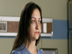 Young woman with bruised face waits in hospital exam room 4K Stock Footage