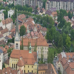 Baroque style church with gothic spire in Ljubljana downtown, tour to Slovenia Stock Footage