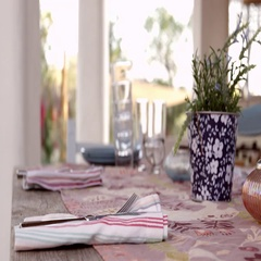 Surface level shot of woman preparing dinner table on patio, shot on R3D Stock Footage