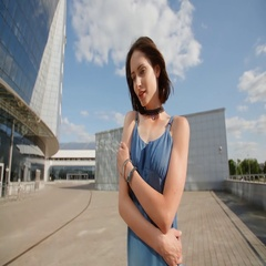 Sad young woman posing with industrial background and glass buildings Stock Footage
