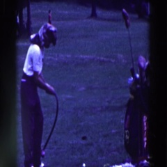 1961: a woman swinging an overly flexible club over her shoulder RIDGEFIELD Stock Footage