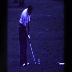 1961: a golfer attempts to hit three golf balls at once with an iron RIDGEFIELD Stock Footage