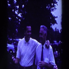 1961: father and son arrive at the golf course. RIDGEFIELD, NEW-JERSEY Stock Footage