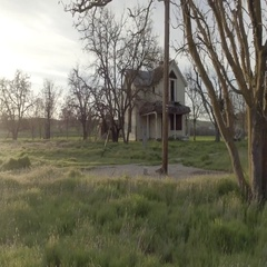 Scary old house in a field Stock Footage