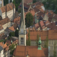 Clock on ancient church tower in European city, cultural heritage preservation Stock Footage