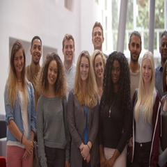 Group of university students standing still in modern lobby Stock Footage