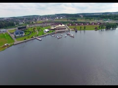 Shooting bird's eye. Flying drone slowly flying over blue water. Beautiful hotel Stock Footage