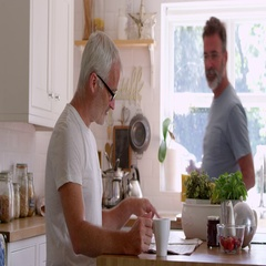 Male Homosexual Couple Having Breakfast At Home Together Stock Footage