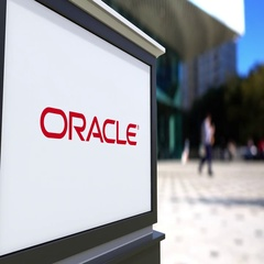 Street signage board with Oracle Corporation logo. Blurred office center and Stock Footage