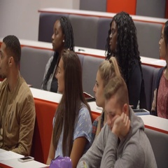 Close up of students sitting in a university lecture theatre Stock Footage