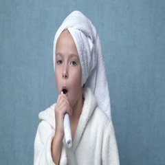 Cute little girl cleaning teeth Stock Footage