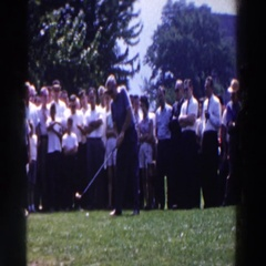 1961: a group of people watching the golf player hitting away the ball Stock Footage