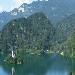 Lake Bled and Julian Alps in Slovenia, fantastic aerial view, tourist attraction Stock Footage