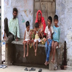 Indian family sits on the street begs for money from a passerby. Pushkar,  India Stock Footage